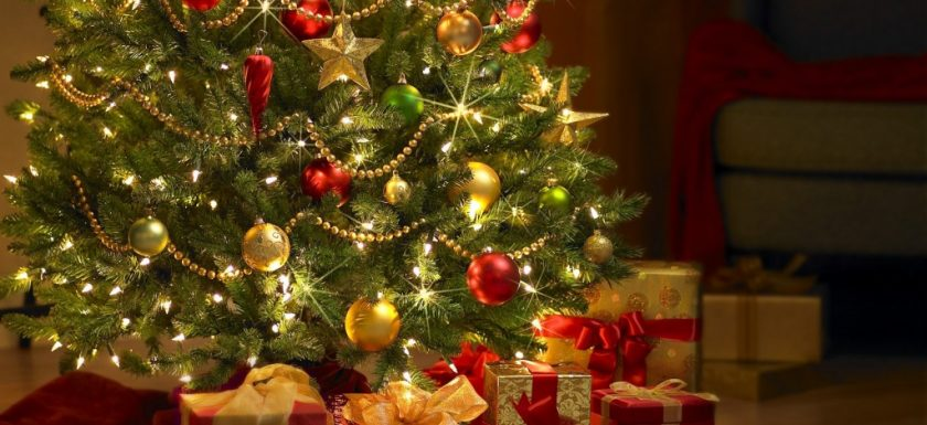 christpass tree with gold and red ornaments and presents
